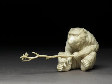 Okimono, or ornament, in the form of a monkey holding a branch